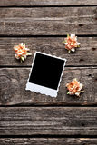 Blank instant photo frame with dried flowers Stock Photo