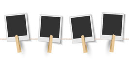 Blank instant photo frames hanging on the clothesline Royalty Free Stock Images