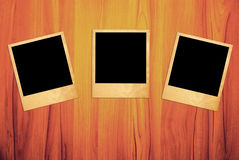 Blank instant photo frames on wooden Royalty Free Stock Image