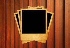 Blank instant photo frames on wooden Royalty Free Stock Images