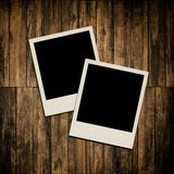 Blank instant photo frames on wooden background. Blank instant photo frames on old wooden background Stock Images