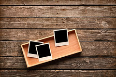 Blank instant photo frames on wooden box Stock Images