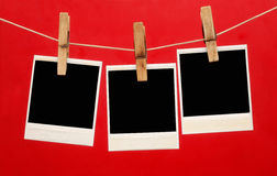Blank instant photo hanging on the clothesline iso Stock Images