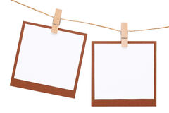 Blank instant photo hung on rope with clothespin Stock Images