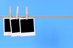 Polaroids photo prints, rope string washing line copy space Stock Photo