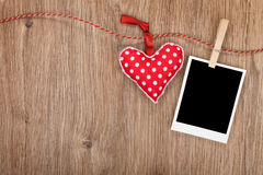 Blank instant photo and red heart hanging on the clothesline Stock Image