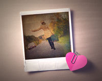 Blank instant photo and small red paper heart Royalty Free Stock Image