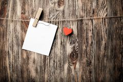 Blank instant photo and small red paper heart stock image