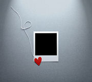 Blank instant photo and small red paper heart Royalty Free Stock Photography