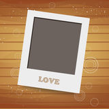 Blank instant photo on wood background Stock Images