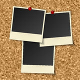 Blank instant photos. Hang on cork board with pushpins Stock Photos