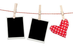 Blank instant photos and red heart hanging Royalty Free Stock Photos