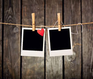 Blank instant photos and small red paper heart Stock Photography