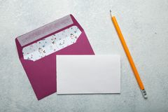 Blank invitation template for a wedding. Pink envelope and vintage white background. Mock-up stock photos