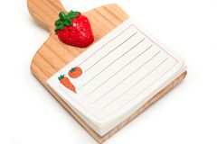 Blank isolated kitchen notepad with clipping path. Lined kitchen notepad on white background with soft shadow Stock Images
