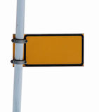Blank isolated sign. Blank yellow isolated steel sign on a pole stock photo