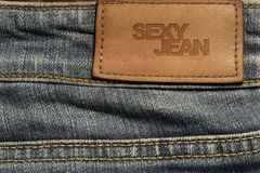 Blank jeans leather label. Close up blank jeans leather label with text sexy jean Stock Image