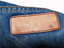 Blank jeans leather label on jean fabric. Close up Royalty Free Stock Images
