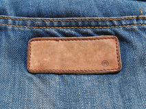 Blank jeans leather label on jean fabric. Close up Royalty Free Stock Photo