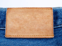 Blank jeans leather label on jean fabric. Close up Stock Photos