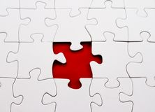 Blank jigsaw puzzle missing piece red Stock Photos