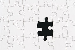 Blank jigsaw puzzle one missing piece. Blank jigsaw puzzle with one missing piece Stock Image