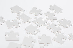 White Jigsaw Puzzle Pieces Stock Images