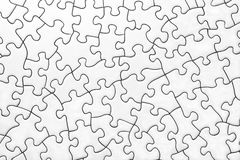 Blank Jigsaw. Surface texture of blank white jigsaw stock photography