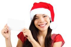 blank jul som rymmer den paper teckenkvinnan Royaltyfri Foto