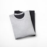 Blank jumpers  on white. Black and grey jumpers  on white Royalty Free Stock Photography