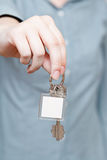 Blank key fob in hand close up Royalty Free Stock Photo