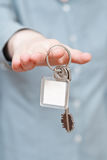 Blank key ring in hand close up Stock Photography