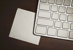 Blank keyboard and note Royalty Free Stock Photo