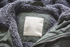 Blank label on the jacket. Cotton Label of the jacket with wool.  Stock Image