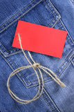 Blank label for text on jeans. Price tag over jeans background place your own text here Stock Photos