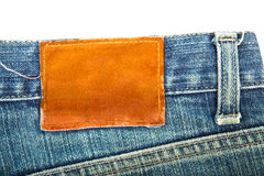 Blank label on used blue jeans Royalty Free Stock Images