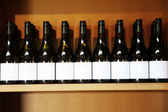 Blank label wine bottles. In rows stock photography