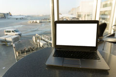 Blank laptop at airport Stock Photography