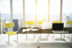 Blank laptop creen on black table in modern office with city vie Royalty Free Stock Photo