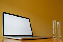 Blank laptop with Glass of Water Royalty Free Stock Photo