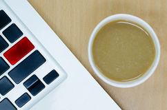 Blank laptop keyboard with coffee paper cup on wooden desk. Blank keyboard, blank keypad royalty free stock photography