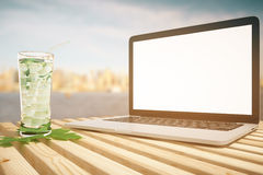 Blank laptop and mohito Stock Photos