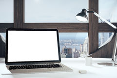 Blank laptop screen in modern room with round window, lamp and c Stock Image