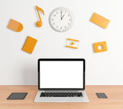 Blank laptop screen with smartphone and digital tablet and social media icons on white wall, mock up royalty free illustration