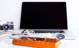 Blank laptop screen with travel accessories for Online travel agency Royalty Free Stock Photos
