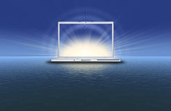 Blank laptop on the sunset Royalty Free Stock Image