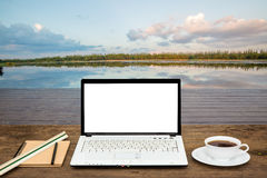 Blank laptop on wooden table Royalty Free Stock Photography