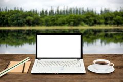 Blank laptop on wooden table Royalty Free Stock Image