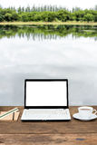 Blank laptop on wooden table Royalty Free Stock Photo