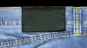 Blank leather jeans label sewed. On a blue jeans Stock Photography